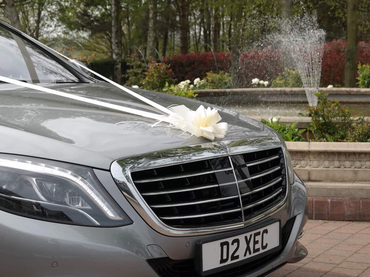 Mercedes S Class with wedding ribbons in Derby