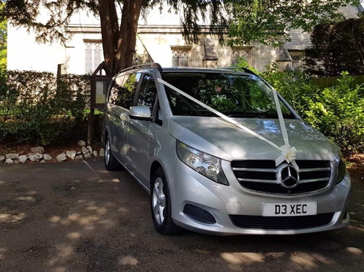 Mercedes V Class with wedding ribbons