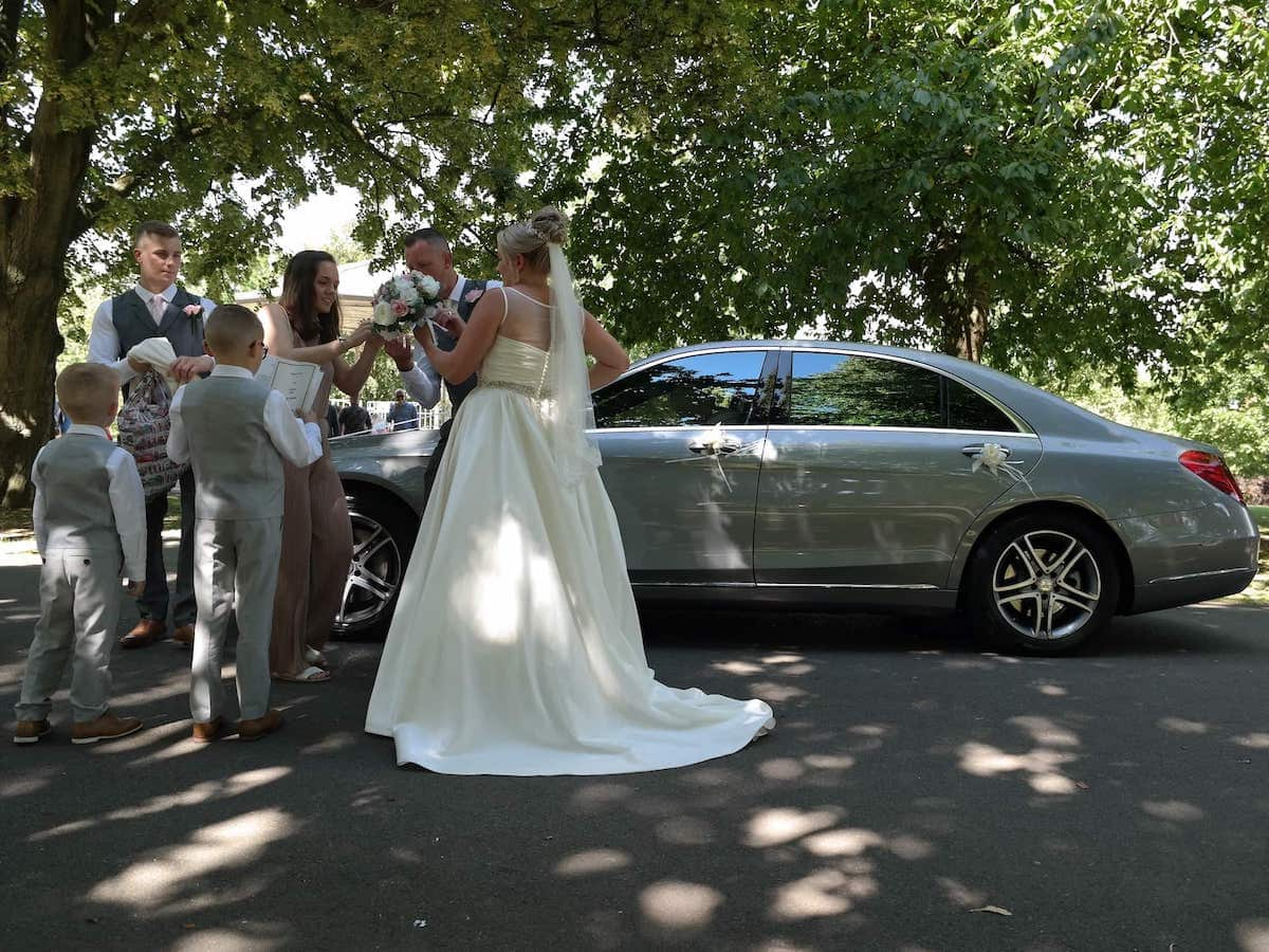 Bride and groom being attended to with Mercedes S Class Wedding Car