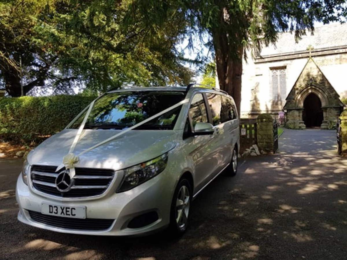 Mercedes V Class in Wedding ribbons at a Derby Church